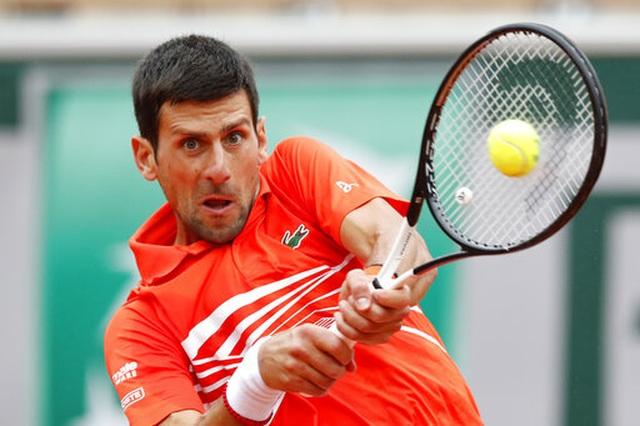 """Roland Garros 2019: Djokovic vào tứ kết """"không đổ mồ hôi"""" - 1"""