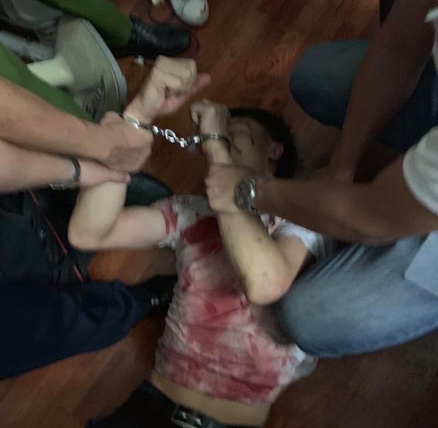 Hà Nội: Khởi tố vụ nam thanh niên bắt bà chủ tiệm cầm đồ làm con tin - 1