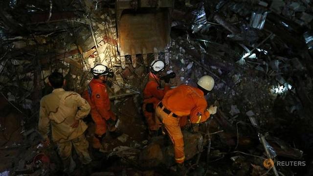 Campuchia khởi tố chủ thầu Trung Quốc vụ sập nhà làm 28 người chết - 1