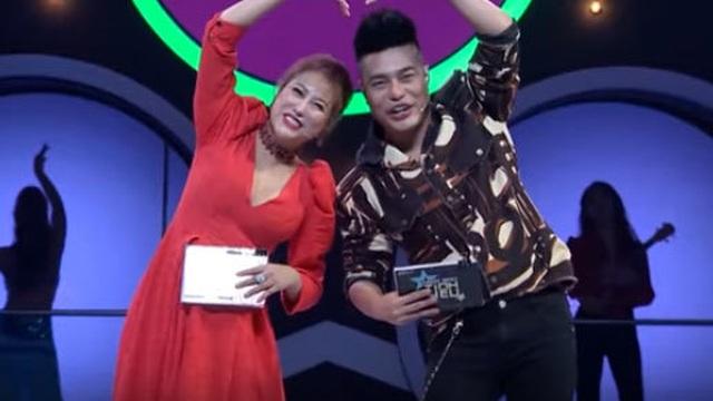 Phi Thanh Vân bị chỉ trích vì vạch áo trai Tây ngay trên sóng truyền hình - 1