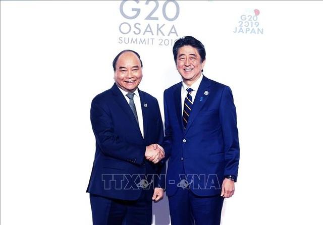 Thủ tướng: Việt Nam đang nỗ lực chuyển đổi số toàn bộ nền kinh tế-xã hội - 1