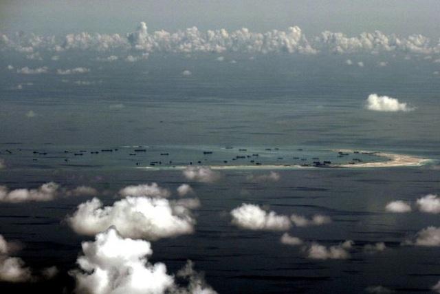 Philippines nói Trung Quốc gây thiệt hại 880 triệu USD đối với các rạn san hô ở Biển Đông - 1