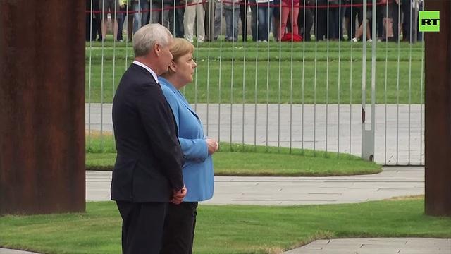 Thủ tướng Merkel run lẩy bẩy lần thứ 3 trong một tháng - 1