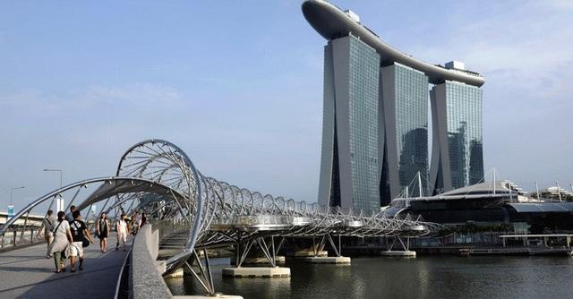Kinh tế Singapore sụt giảm bất ngờ, xuất khẩu của Trung Quốc cũng giảm mạnh - 1