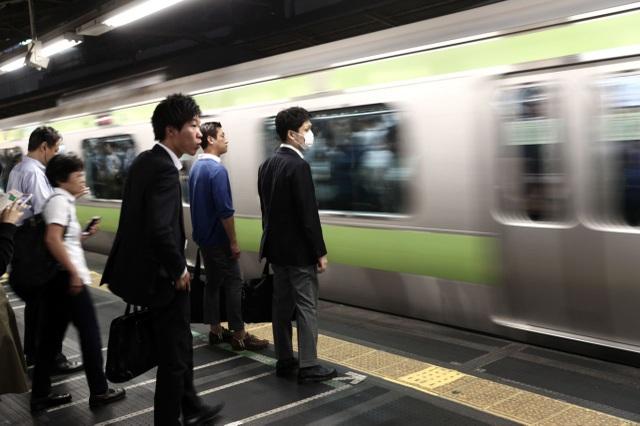 Tokyo khuyến khích 600.000 người làm việc ở nhà để tránh giao thông quá tải - 1
