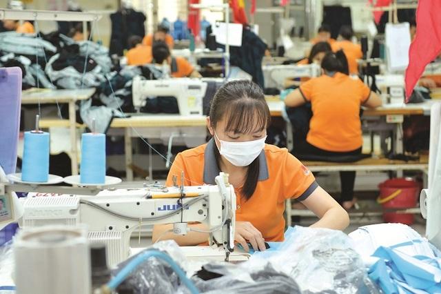 Đề nghị không khống chế số giờ làm thêm trong ngành dệt may - 1