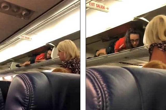 Tiếp viên hàng không hành động lạ, chui vào hộc hành lý nằm - 1