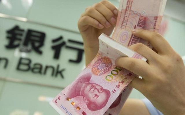 Trung Quốc phá giá nhân dân tệ kỷ lục, tiền Việt sẽ ra sao? - 1
