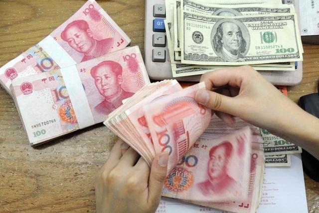 Trung Quốc hứa sẽ không phá giá đồng nhân dân tệ sau khi bị Mỹ cho là kẻ thao túng tiền tệ - 1