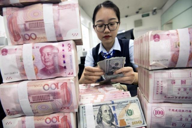 Mỹ đừng nên hy vọng rằng Trung Quốc sẽ giữ đồng nhân dân tệ ổn định một mình - 1