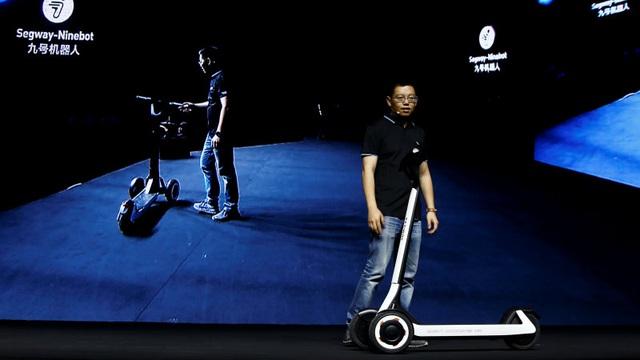 Hãng xe Trung Quốc trình làng scooter có khả năng tự lái đến trạm sạc điện - 1