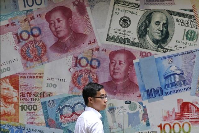 Đồng nhân dân tệ đạt mức thấp kỉ lục trong 11 năm, Trung Quốc kiểm soát thế nào? - 1