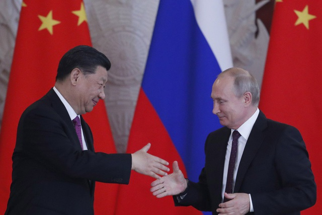 Trung Quốc và Nga hợp tác giảm sự phụ thuộc vào đồng đô la Mỹ - 1