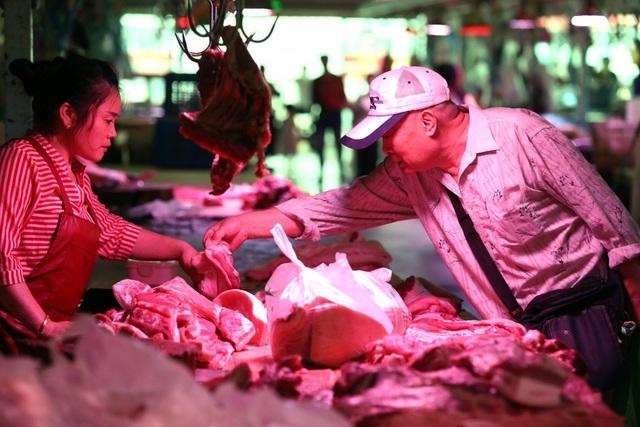 Trung Quốc vật lộn với cơn khát thịt lợn - 1