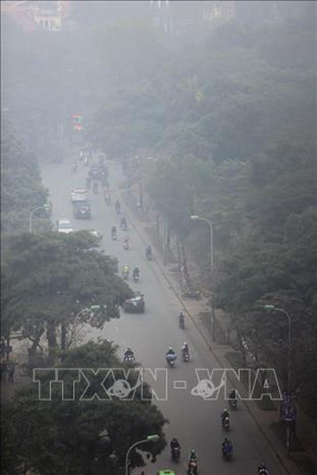 Không khí Hà Nội ô nhiễm ở mức nghiêm trọng - 2