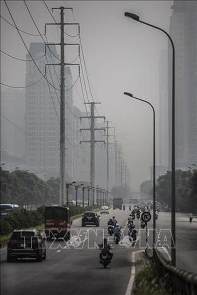 Không khí Hà Nội ô nhiễm ở mức nghiêm trọng - 4