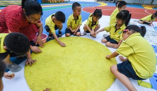 Địa phương Trung Quốc tăng lương gấp ba để thu hút giáo viên - 2