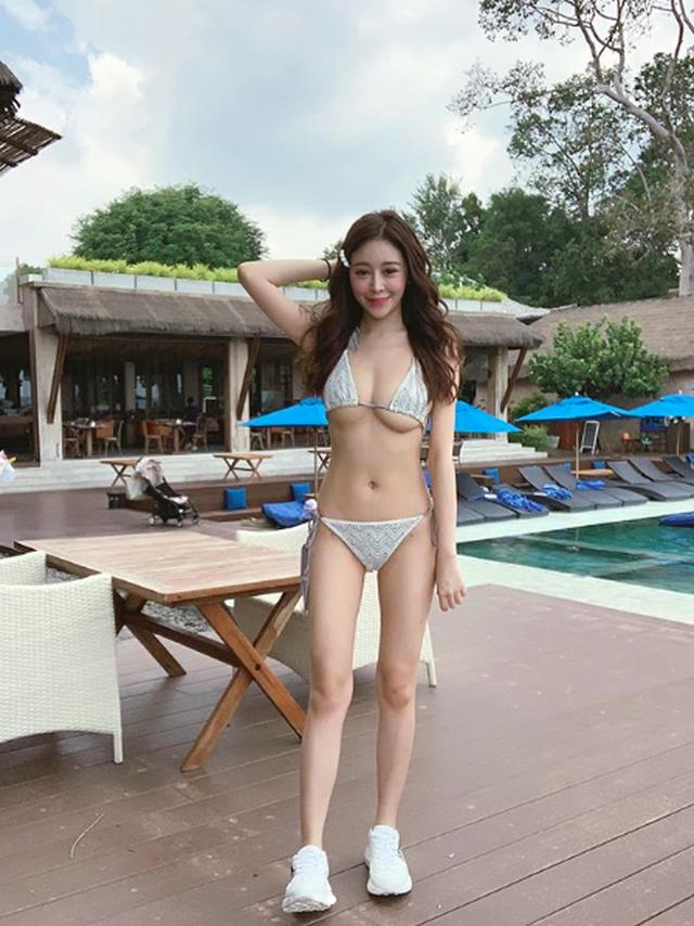 Trung Quốc: Cô gái mặc bikini bán trà sữa gây xôn xao - 6