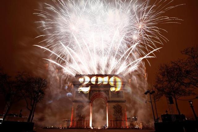 Lễ đón năm mới tại Khải Hoàn Môn, nơi diễn ra các cuộc biểu tình của phong trào Áo vàng tại Pháp trong những tuần gần đây. (Ảnh: Reuters)