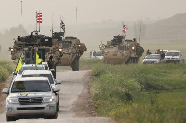 Liên quân quốc tế chống IS tuyên bố bắt đầu rút khỏi Syria - Ảnh 1.
