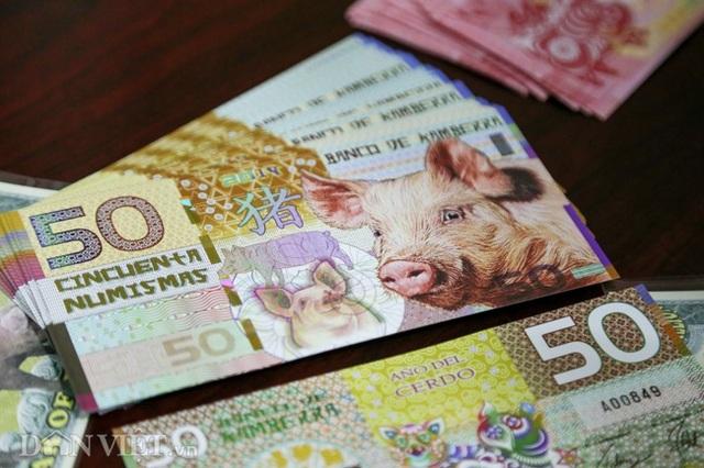 Tiền 2 USD in hình con heo đắt như tôm tươi trước Tết Kỷ Hợi 2019 - Ảnh 2.