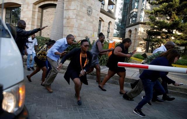 Khách sạn sang trọng chìm trong khói lửa do bị khủng bố, 15 người chết - Ảnh 9.