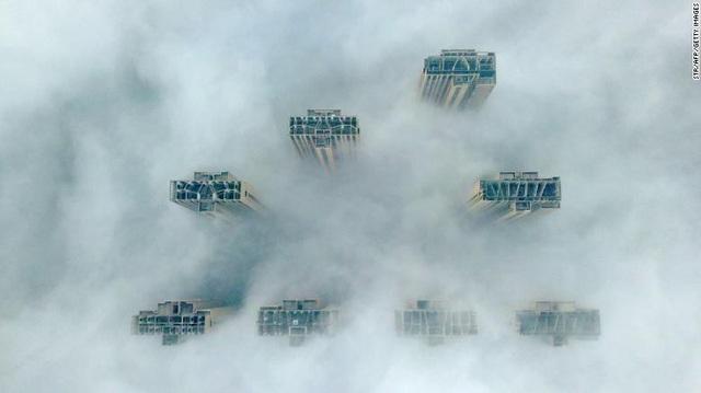 """Nhiều thành phố ở châu Á """"nghẹt thở"""" vì bụi mịn và khói độc - Ảnh 3."""