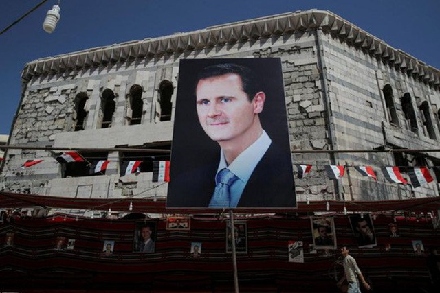 Ông Assad: Tái thiết Syria sẽ mất 400 tỉ USD. Ảnh: Reuters