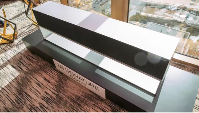 LG trình diễn TV màn hình cuộn đầu tiên trên thế giới - Ảnh 5.