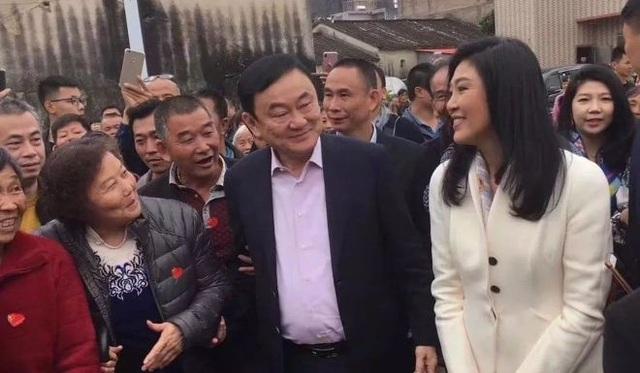 Nhiều người thân trong họ đã đón tiếp anh em cựu thủ tướng Thái Lan. (Ảnh: SCMP)