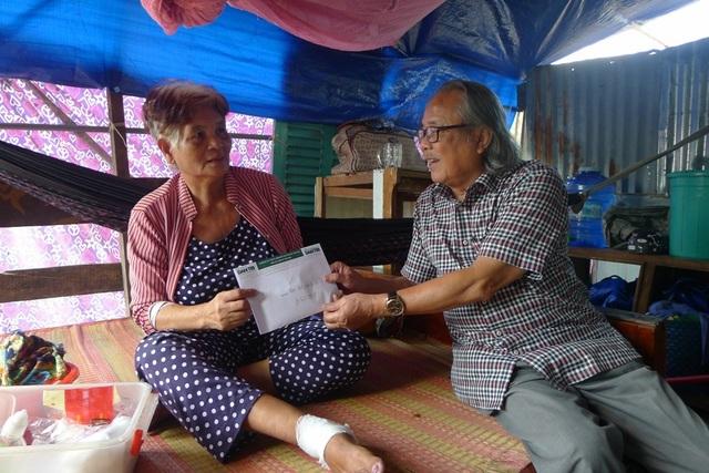 Bạn đọc Dân trí giúp đỡ 14 hộ dân bị thiệt hại do lũ lụt ở Phú Quốc - 5