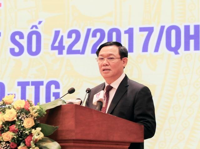 Phó Thủ tướng: Cần đề cao vai trò xử lý nợ xấu của chính ngân hàng - 1