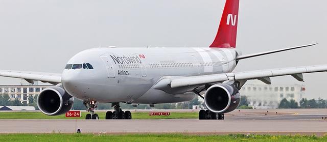 Máy bay Nga hạ cánh khẩn cấp vì hành khách đòi mở cửa ở độ cao 10.000 m - 1