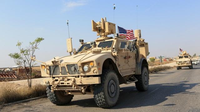 Lính Mỹ tại Syria không rút về nước như tuyên bố của ông Trump - 1