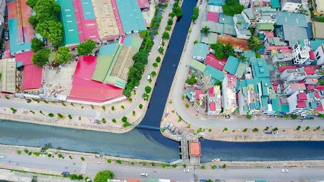 Mỗi ngày các dòng sông Hà Nội nhận 600.000 m3 nước thải - 1