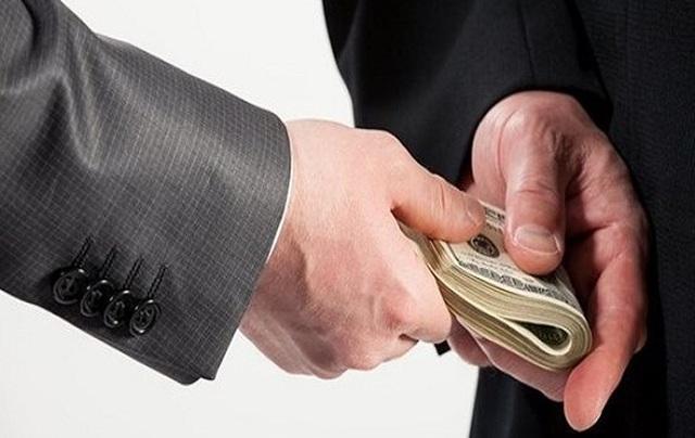"""Nhiều nguy cơ rửa """"tiền bẩn"""" qua ngân hàng, bất động sản - 1"""