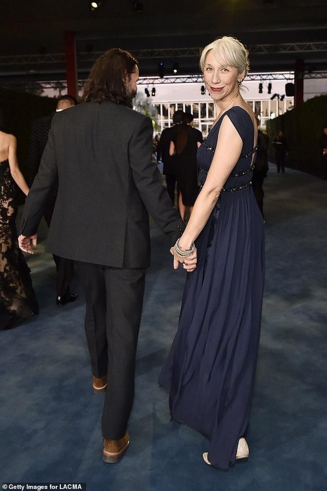 Người phụ nữ có thể khiến Keanu Reeves nắm tay trên thảm đỏ là ai? - 2