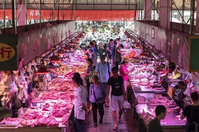 Chỉ số giá tiêu dùng Trung Quốc tăng kỉ lục do thiếu hụt thịt lợn trầm trọng - 1