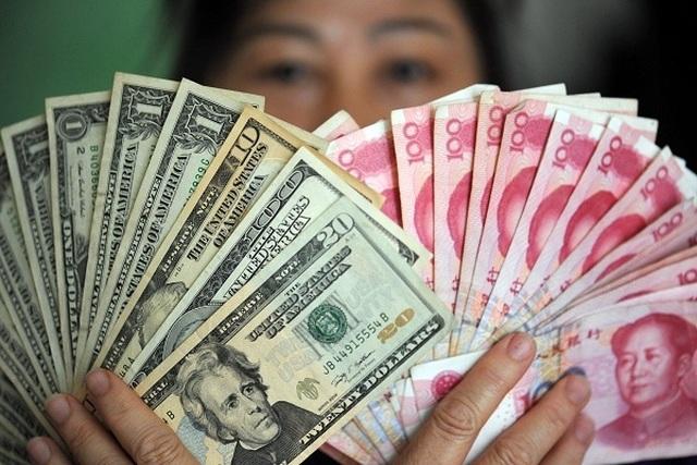 Trung Quốc vùng vẫy thoát khỏi 'vòng kim cô' đô Mỹ - 1