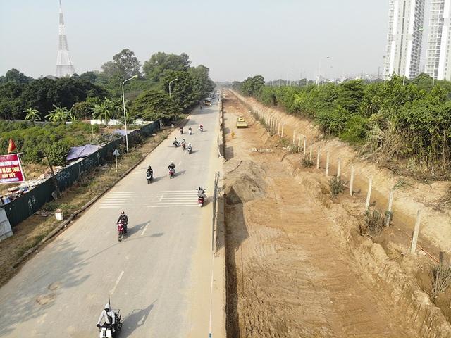Tiếp tục xén dải phân cách, mở rộng đường gom Đại lộ Thăng Long - 4