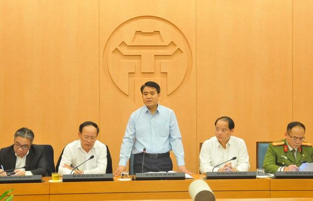 Hà Nội: Các quận đề xuất tưới nước rửa đường để giảm ô nhiễm không khí - 1