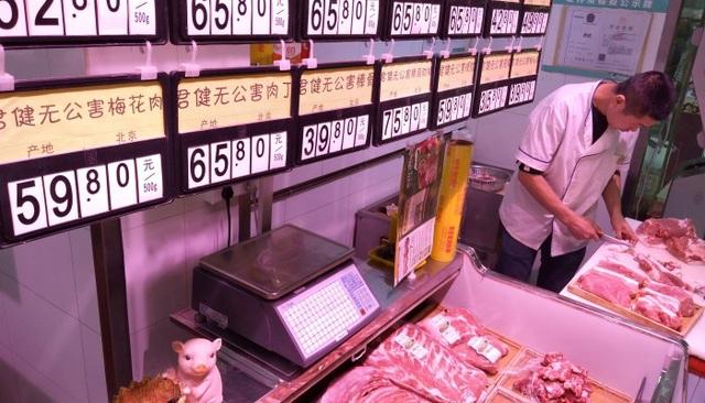 Trung Quốc: Mở tài khoản ngân hàng được tặng thịt lợn - 1