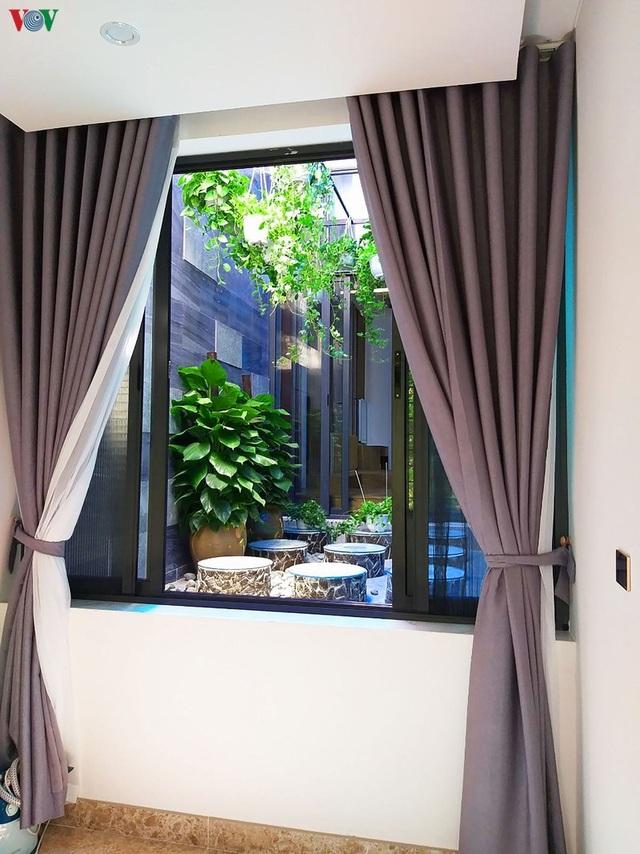 Nhà phố với nội thất hiện đại và không gian giếng trời xanh mát - 15