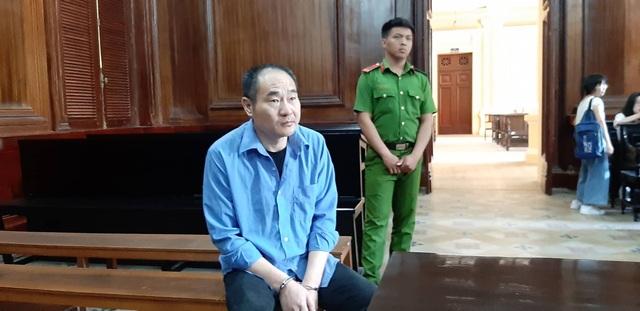 Người đàn ông Trung Quốc trộm tiền trên máy bay lãnh án - 1