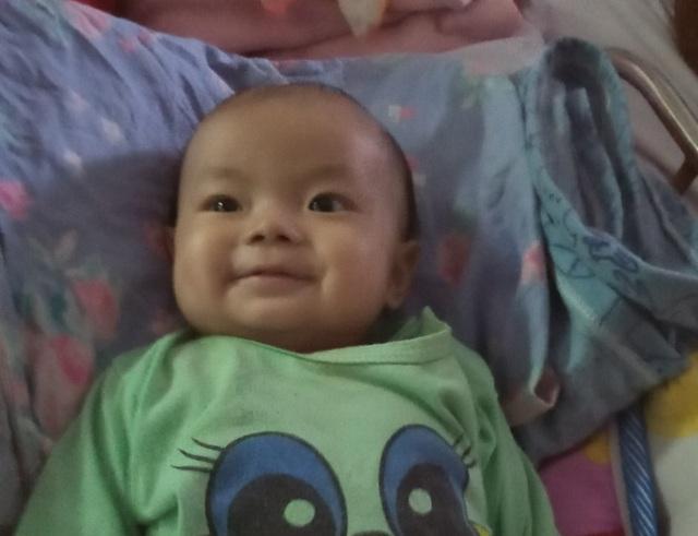 Bé gái 5 tháng tuổi được bạn đọc giúp đỡ vượt mặt tử thần lần đầu về quê đón Tết - 2