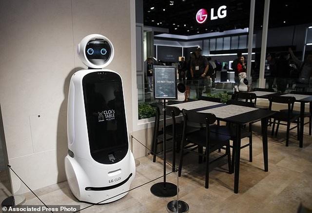 Xem robot trổ tài nấu ăn như người thật - 1