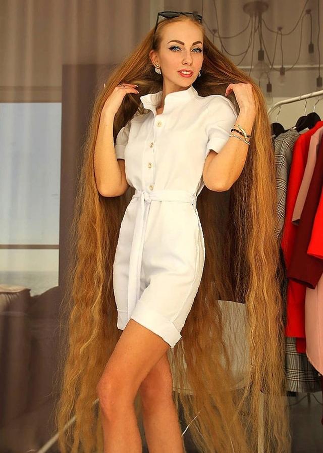 Bí quyết nuôi mái tóc dài suông mượt của cô gái xinh đẹp - 1
