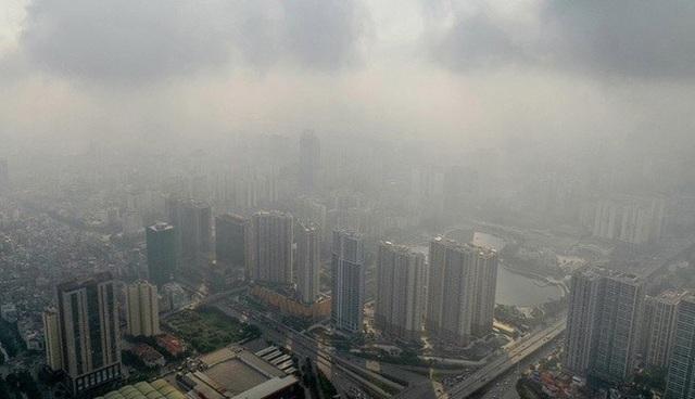 Không khí Hà Nội lại ô nhiễm nặng - 1