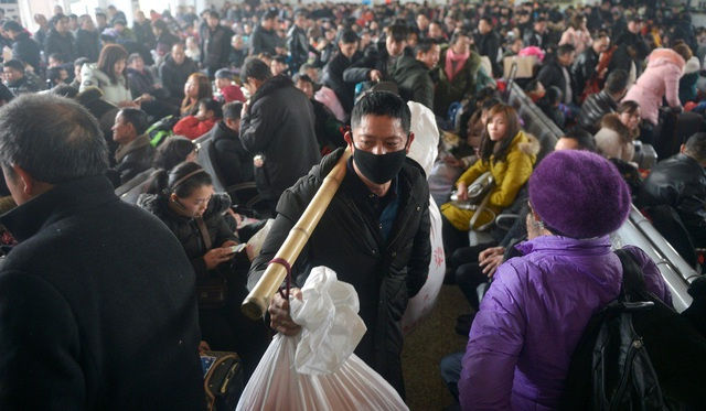 """""""Biển người"""" Trung Quốc trong cuộc di dân khổng lồ về nhà ăn Tết - 6"""