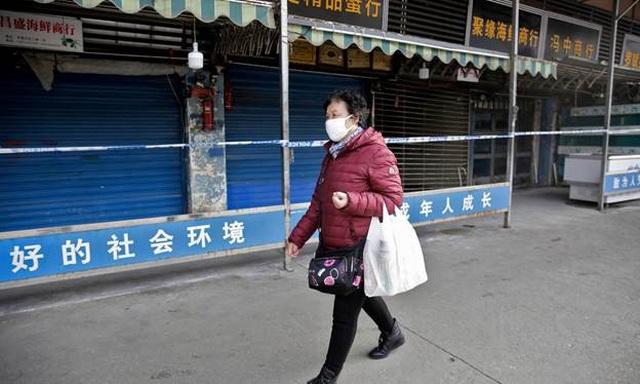 Trung Quốc đón Tết trong nỗi lo dịch bệnh - 1